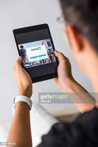 A man holds an Apple iPad Mini as he uses LinkedIn app on October 4 2017 in Hong Kong Hong Kong