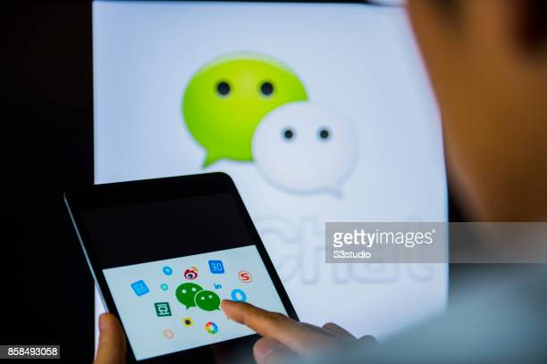 A man holds an Apple iPad Mini as he uses WeChat app on October 6 2017 in Hong Kong Hong Kong