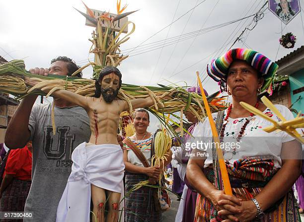 A man holds an image of Christ during The Procession of the Christs on March 24 2016 in Izalco El Salvador This procession is considered the largest...