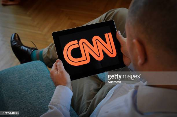 A man holds an iPad with a CNN logo on it's screen on November 10 2017