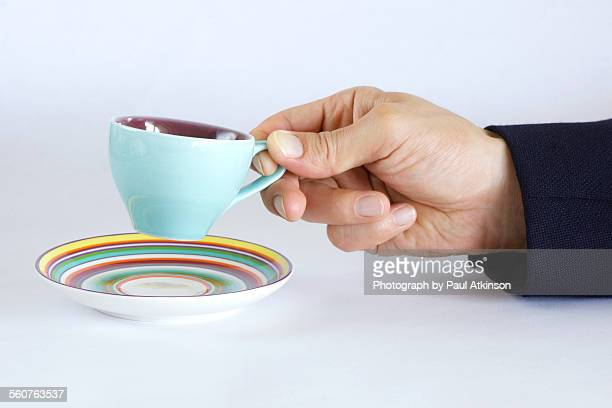 Man holds espresso cup