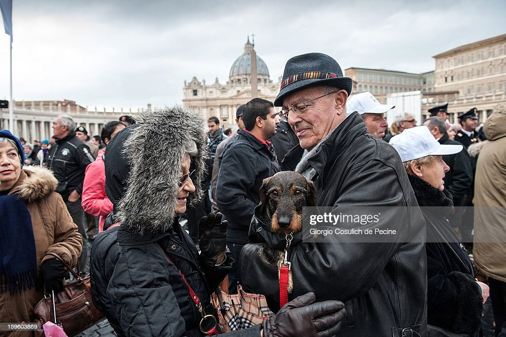 A man holds his dog in front of the Saint Peter Basilica, during a traditional day of blessing of the animals, on January 17, 2013 in Vatican City, Vatican. Every year, during the feast of St. Anthony the Abbot, the traditional blessing of the animals is celebrated.