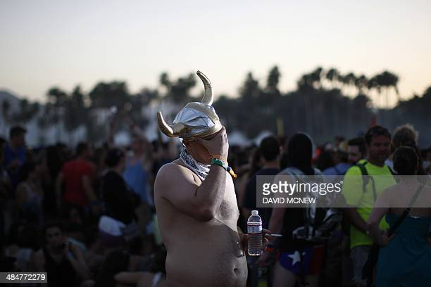 A man holds his face at the Coachella Valley Music Arts Festival at the Empire Polo Club in Indio California April 13 2014 The annual music festival...