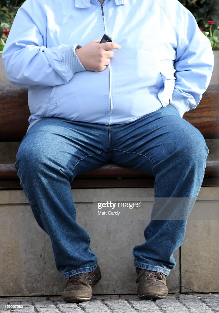 A man holds his mobile phone as he sits on a bench on January 7, 2013 in Bristol, England. A government-backed TV advert - made by Aardman, the creators of Wallace and Gromit - to promote healthy eating in England, is to be shown for the first time later today. England has one of the highest rates of obesity in Europe - costing the NHS 5 billion GDP each year - with currently over 60 percent of adults and a third of 10 and 11 year olds thought to be overweight or obese.