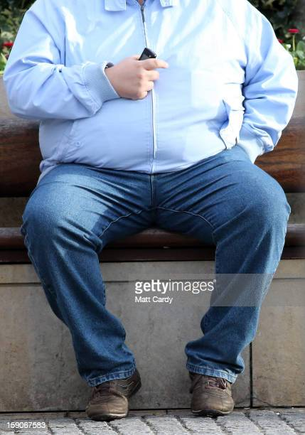 A man holds his mobile phone as he sits on a bench on January 7 2013 in Bristol England A governmentbacked TV advert made by Aardman the creators of...