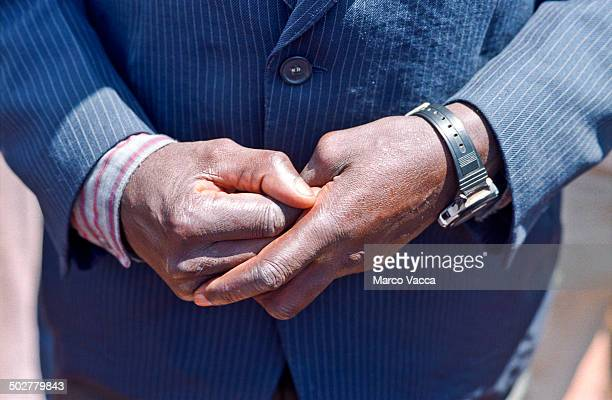 Man holds his own hand