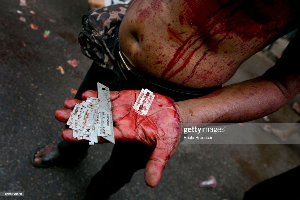 A man holds razors, used to cut the skin in self-flagellation rituals, in his hand as Shia muslims mark the Day of Ashura on November 25, 2012 in Yangon, Myanmar. The day of Ashura is a national holiday held on the 10th day of Muharram in the Islamic calendar, with men beating themselves as they mourn the martyrdom of Husayn ibn Ali, the grandson of the Islamic Prophet Muhammad. There are approximately 20,000 Shia muslims in Myanmar.