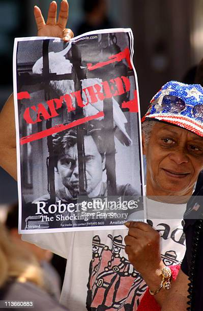 Man holds sign touting the arrest of actor Robert Blake outside Van Nuys Superior Court after Blake's arraignment in the slaying of his wife Bonny...