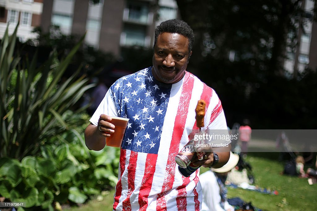 A man holds some food and drink on June 30, 2013 in London, England. American Democrats living in London gather in Portman Square for the largest Independence Day celebration in London ahead of the American federal holiday on the 4th July which commemorates the Declaration of Independence on July 4, 1776 which declared them the USA free from the Kingdom of Great Britain.