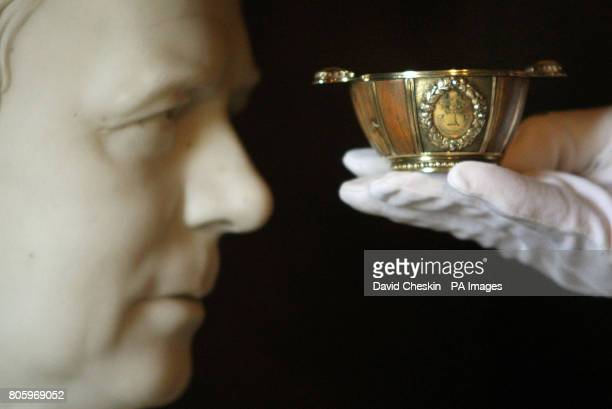 A man holds the WaterlooTree Quaich which belonging to Sir Walter Scott which was returned after being missing for sixteen years and which will go on...