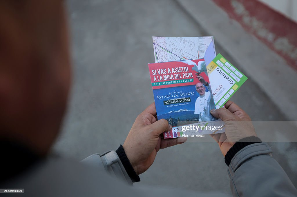 A man holds tickets to enter to the mass near the esplanade where Pope Francis will give a mass for 300 thousand people during the preparations ahead the visit of Pope Francis to Mexico at El Caracol on February 11, 2016 in Ecatepec, Mexico.