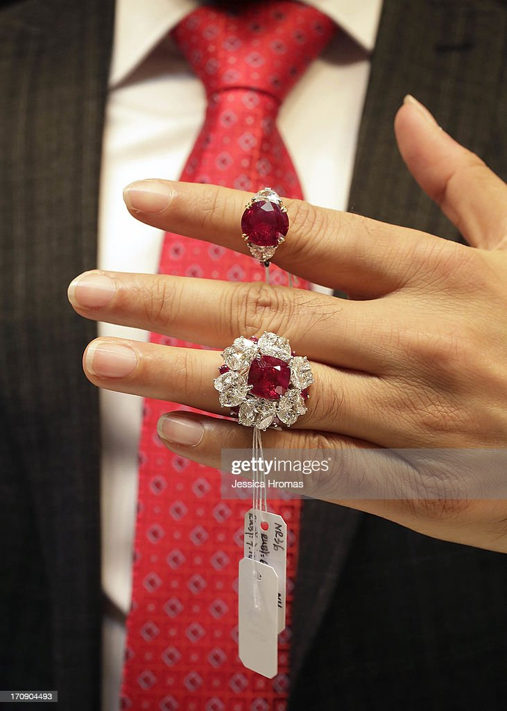 A man holds two rings which are for sale at the Fai Dee Limited Hong Kong jewellers stall at the Hong Kong Jewellery and Gem Fair on June 20, 2013 in Hong Kong, Hong Kong. The top ring has a 6.90 ct Pigeon Blood Ruby from Myanmar and is valued at $1.3 million USD. The bottom ring has a 7.02 ct Pigeon Blood Ruby cushioned in diamonds and is valued at $800,000-USD. The June Hong Kong Jewellery & Gem Fair runs from June 20 - 23.