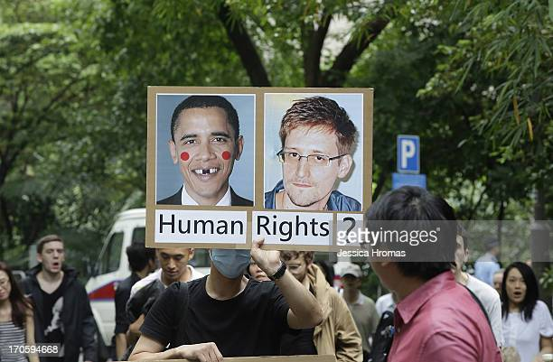 A man holds up a protest sign during the protest rally to support Edward Snowden in Hong Kong on June 15 2013 in Hong Kong Hong Kong Former CIA...