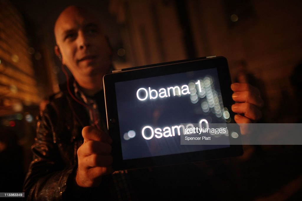 A man holds up a scoreboard on his ipad displaying Obama - one, Osama - nil, as thousands of people celebrate in the streets at Ground Zero, the site of the World Trade Centre, waving American flags and honking horns to celebrate the death of al Qaeda founder and leader Osama bin Laden on May 1, 2011 in New York City. President Barack Obama announced the death of Osama bin Laden during an address to the nation from the White House in Washington. The mastermind of the September 11 terrorist attacks was killed in an American military operation at a compound in Pakistan.