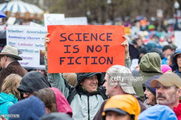A man holds up a sign at the Science March on the Boston Common on April 22 2017 in Boston Massachusetts The event is being described as a call to...