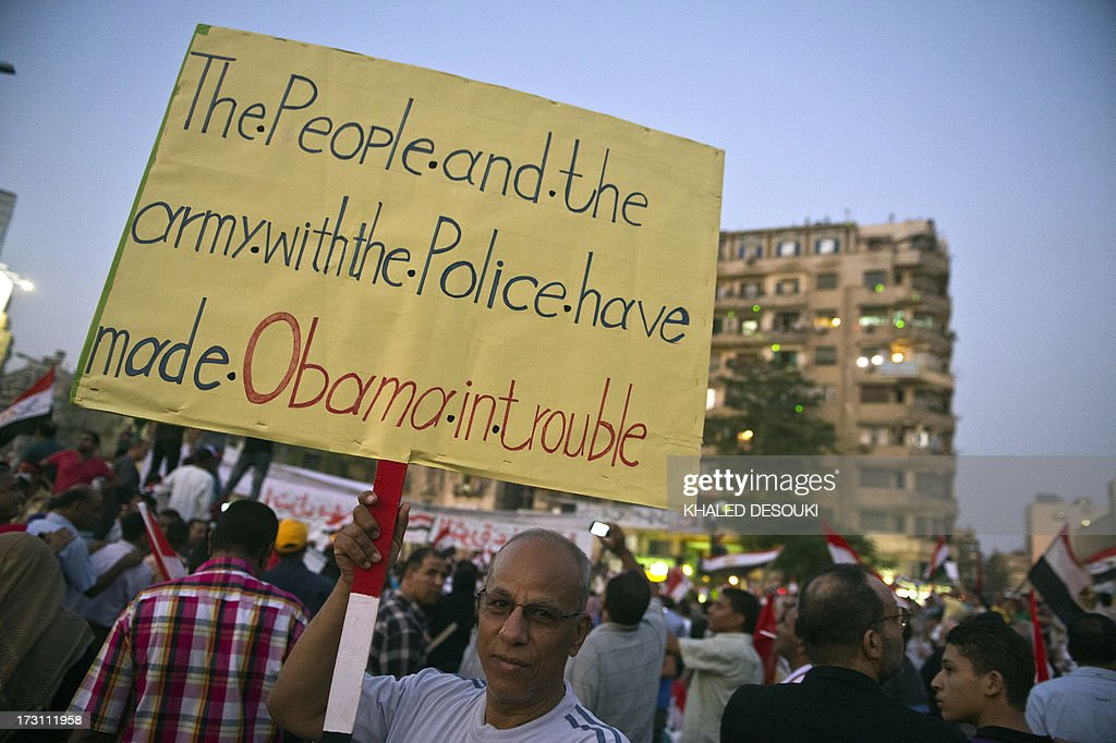 A man holds up a sign during a rally on July 7 as opponents of Egypt's deposed Islamist president Mohamed Morsi packed Cairo's Tahrir Square in their...