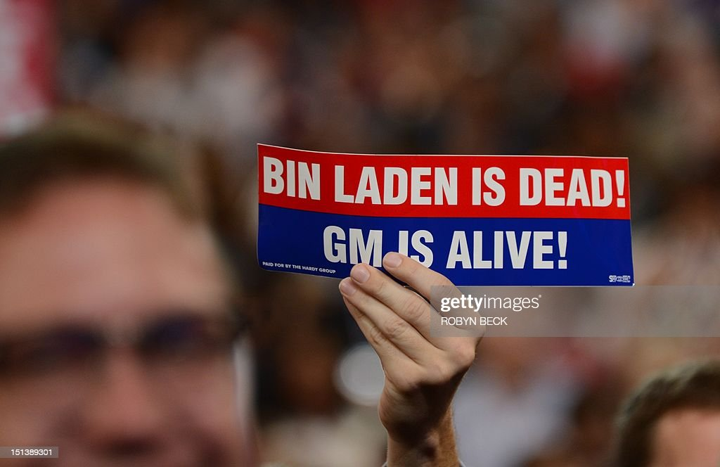 A man holds up a sign reading 'Bin Laden is dead! GM (General Motors) is alive!) at the Time Warner Cable Arena in Charlotte, North Carolina, on September 6, 2012 on the final day of the Democratic National Convention (DNC). US President Barack Obama is expected to accept the nomination from the DNC to run for a second term as president. AFP PHOTO Robyn BECK