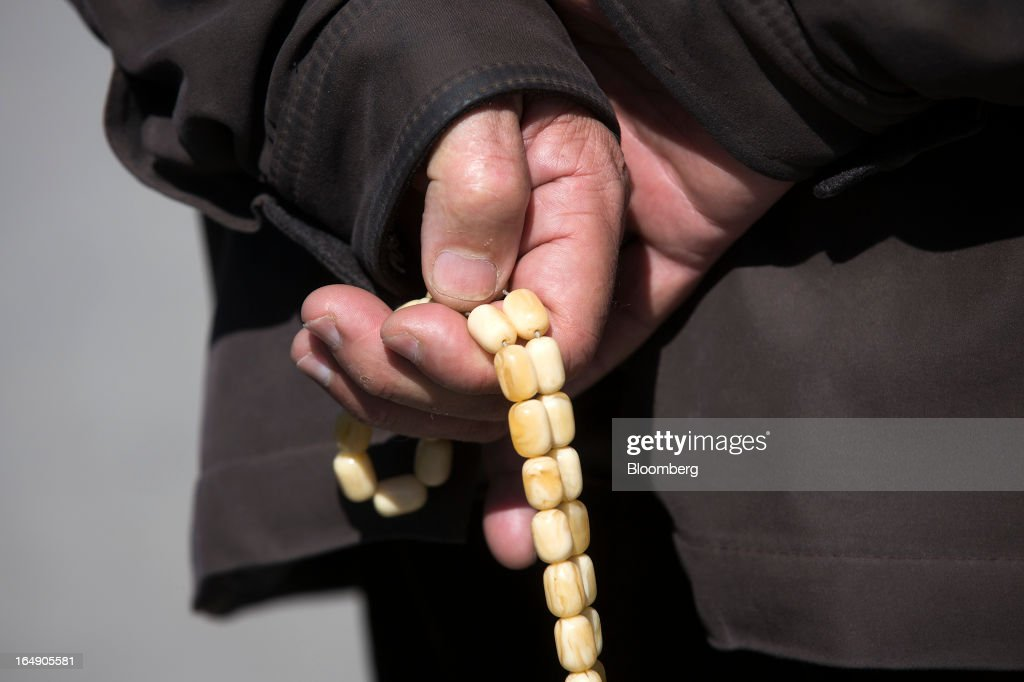A man holds worry beads in Nicosia, Cyprus, on Friday, March 29, 2013. Cypriots face a second day of bank controls over their use of the euro as officials in Europe urged the country to move quickly to lift the restrictions, the first time they have been imposed on the common currency. Photographer: Simon Dawson/Bloomberg via Getty Images
