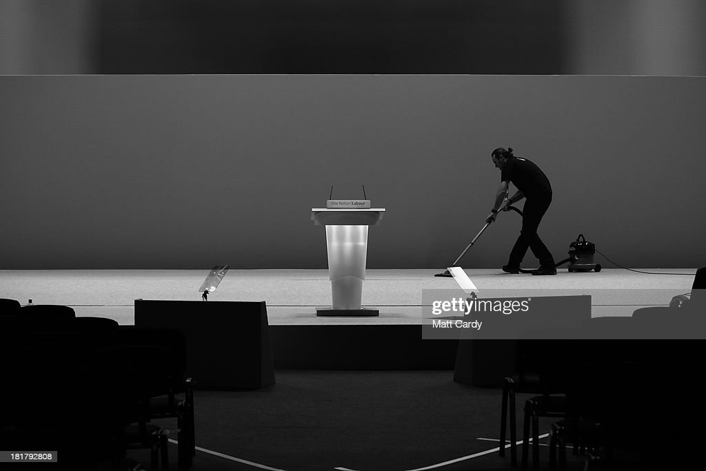 A man hoovers the carpet on the stage following the end of the Labour Party conference on September 25, 2013 in Brighton, England. Today was the last day of opposition Labour Party's annual conference in the southern English coastal town.
