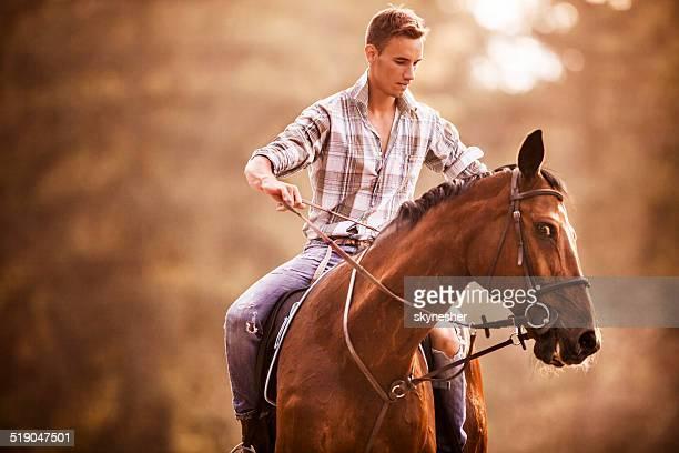 Man horseback riding.