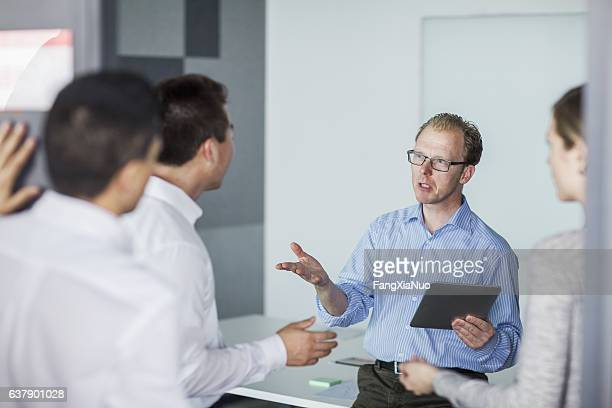 Man hosting business meeting in office
