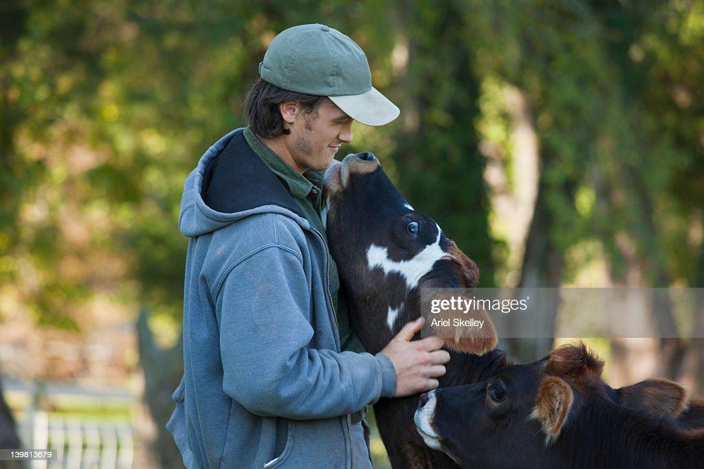 Man hugging calf