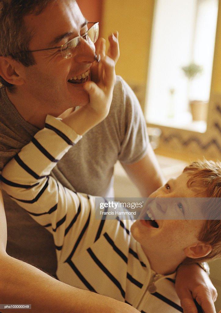 Man hugging child : Stock Photo