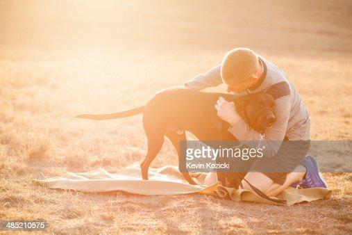 Man hugging dog : Stock Photo