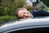 Man hugging his car