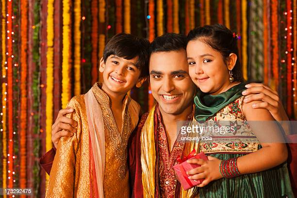 Man hugging his children on Diwali