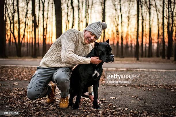 Man hugging his pet dog