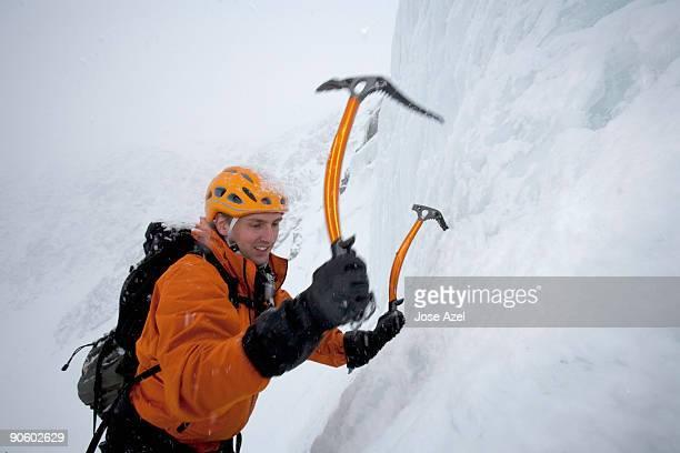 A man ice climbing on Tuckerman's Ravine on Mt. Washington in the White Mountains of New Hampshire