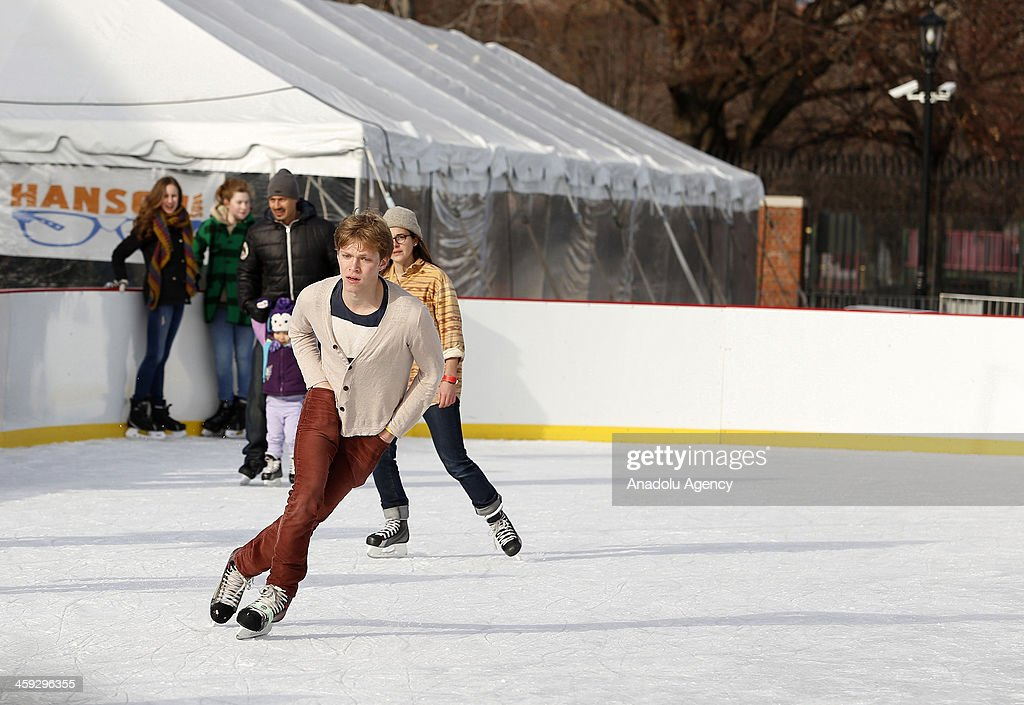 A man ice skates at the McCarren Park pool in New York,United States on December 24,2013. after McCarren park pool converted to an ice skating area. Pool hosts 800 visitors everyday, without regard to cold weather American people have fun in McCarren park pool in New York,United States,on December 24,2013.