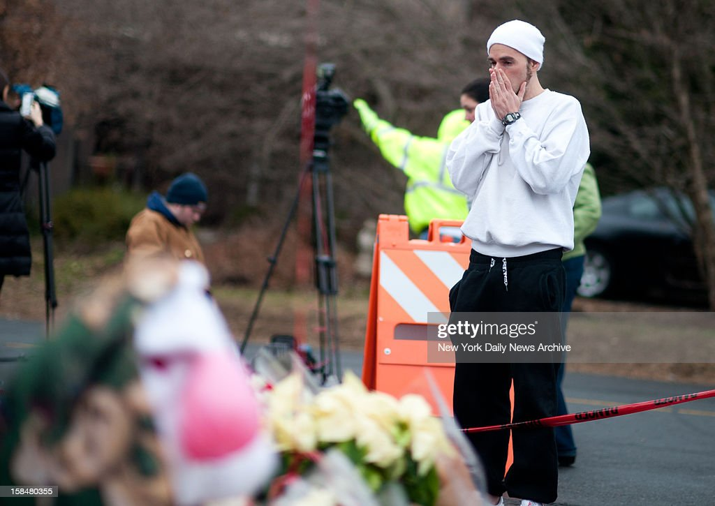 A man identifing himself as Jonathan Lanza, the uncle of shooter Adam Lanza, stops by a memorial to pay his respects to the 27 people including 20 children killed in the Sandy Hook Elementary School shooting.