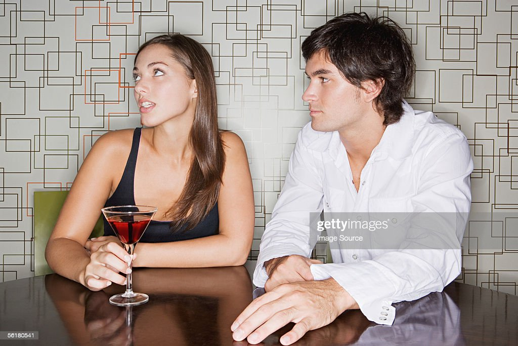 Man ignoring man in a bar : Stock Photo