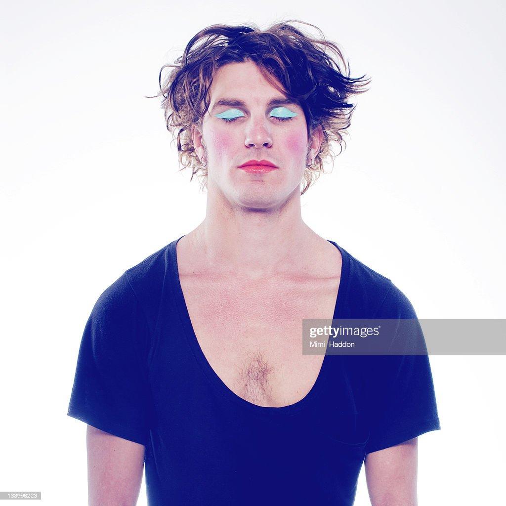 Man in 20's Wearing Bright Blue Eyeshadow