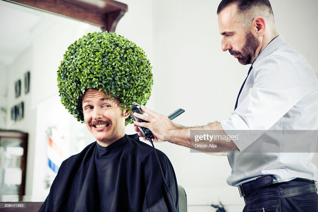 Homme dans un salon de coiffure : Photo