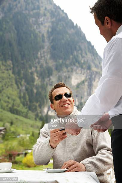 Man in a Cafe in Mountain Range