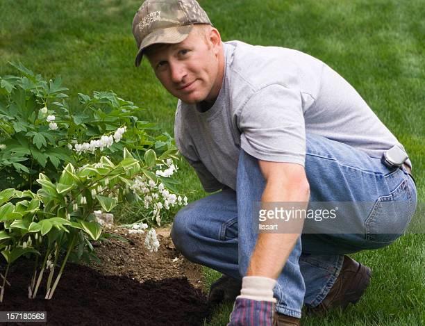 Man in a cap landscaping his garden