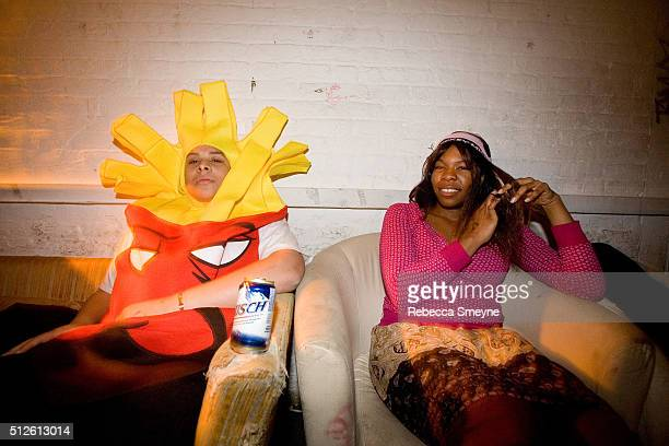 A man in a french fry costume 'Frylock' sits next to a woman after the Mae Shi set at the music venue Death By Audio on December 14 in Brooklyn NY