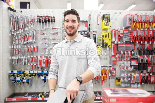 Man in a hardware store : Stock Photo