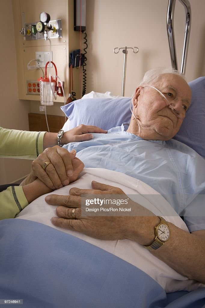 Man in a hospital bed : Stock Photo