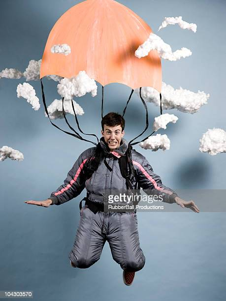 man in a jumpsuit parachuting
