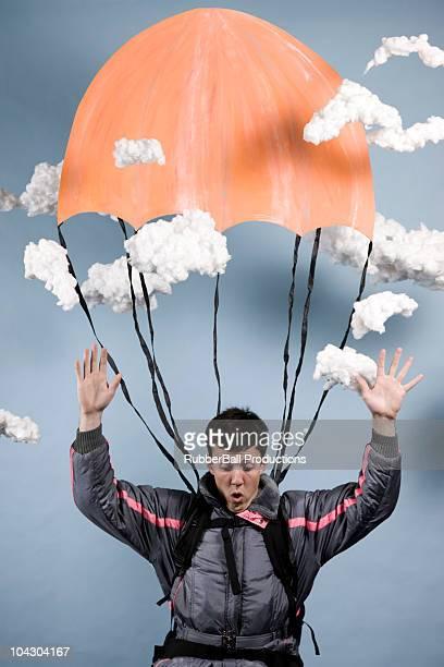 man in a jumpsuit parachuting