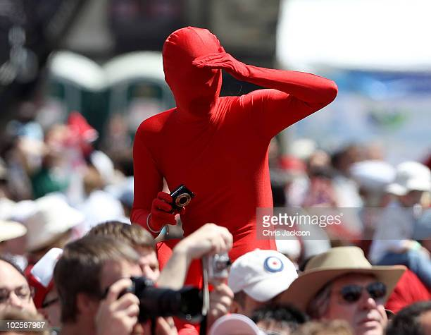 A man in a morph suits takes photographs from the crowd during Canada Day celebrations on Parliament Hill on July 1 2010 in Ottawa Canada The Queen...