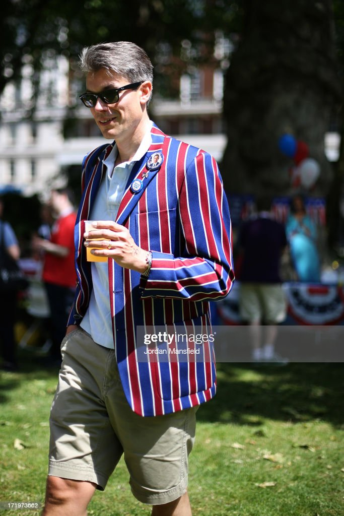 A man in a red, white and blue blazer holds a drink on June 30, 2013 in London, England. American Democrats living in London gather in Portman Square for the largest Independence Day celebration in London ahead of the American federal holiday on the 4th July which commemorates the Declaration of Independence on July 4, 1776 which declared them the USA free from the Kingdom of Great Britain.