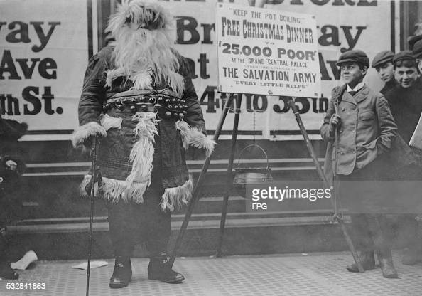 man in a Santa Claus outfit helping to publicize a free Christmas ...