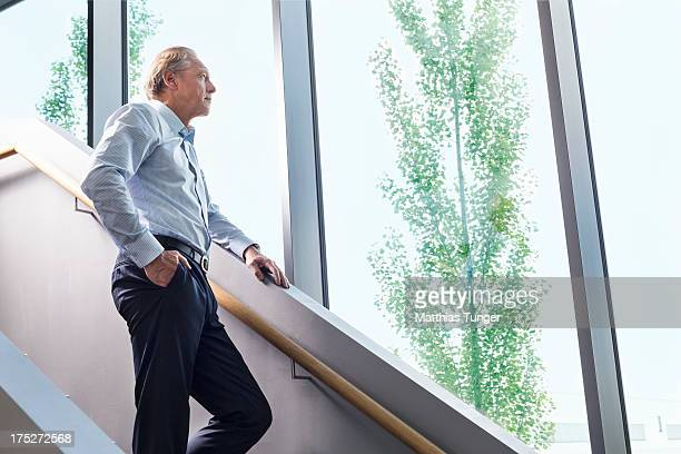 Man in a smart business outfit looking outdoors