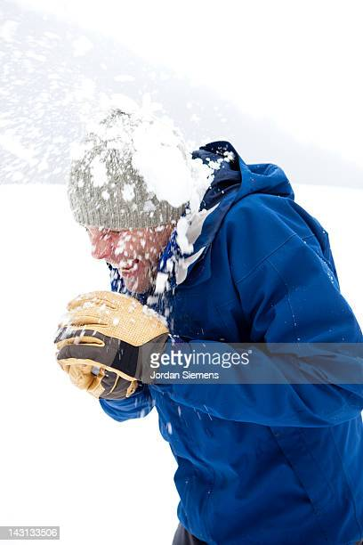 Man in a snowball fight.