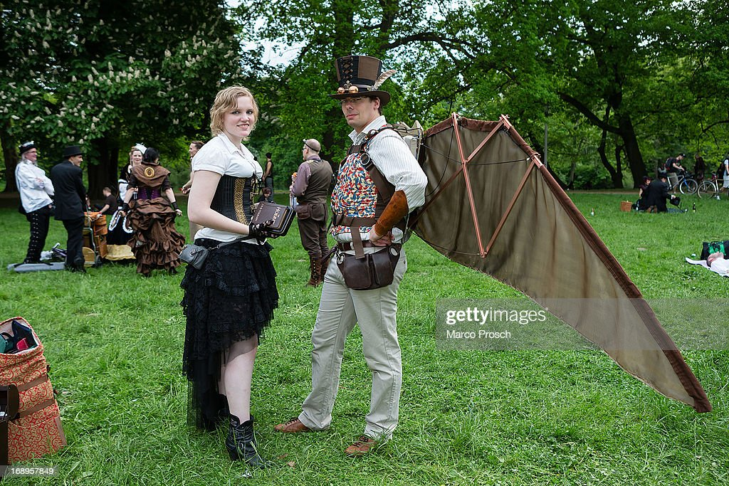 A man in a steam-punk outfit with self-made wings and a woman in Victorian clothing holding the book 'The Hobbit' attend the traditional park picnic on the first day of the annual Wave-Gotik Treffen, or Wave and Goth Festival, on May 17, 2013 in Leipzig, Germany. The four-day festival, in which elaborate fashion is a must, brings together over 20,000 Wave, Goth and steam punk enthusiasts from all over the world for concerts, readings, films, a Middle Ages market and workshops.